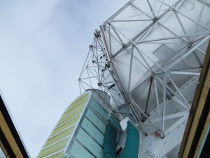 The giant telescope turns toward the open ceiling.