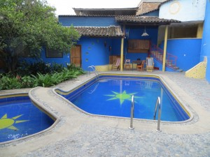 Our room (door behind the pool) at Jardin Escondido hostel in Vilcabamba.