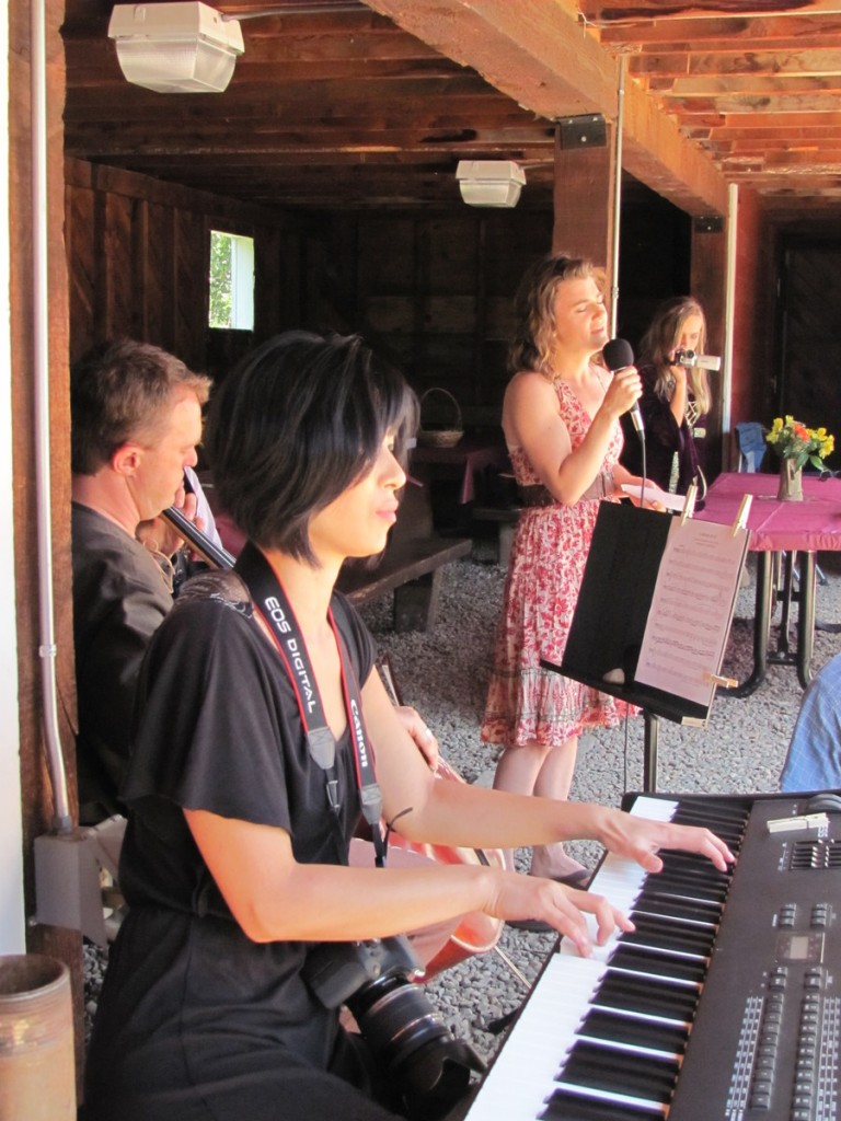 More musicians: Our vocalist, Corinne, accompanied by Cheri on the piano and John on the cello.