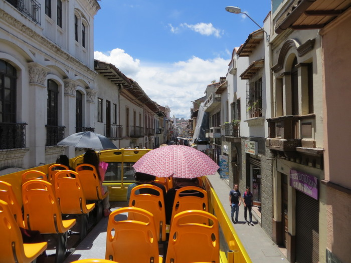 Touring Cuenca's streets on a double-decker bus.