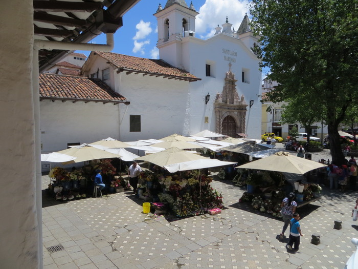 Flower market in front of an old church.