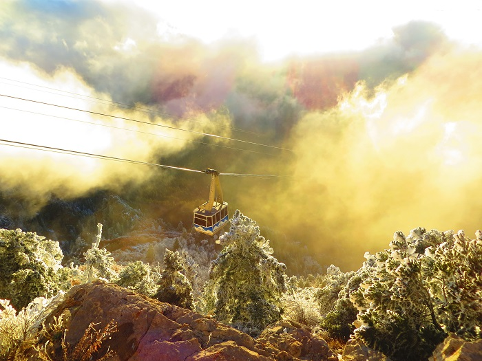 The Sandia Peak Tram descending into the clouds.