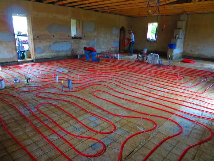 Radiant in-floor heating in earthbag house